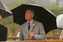© Licensed to London News Pictures. 02/07/2012. Camborne, UK. Prince Charles walks across bridge at Heartlands in the rain. The Duke and Duchess of Cornwall are on a three day tour of Cornwall and the Isles of Scilly. Photo credit : Ashley Hugo/LNP
