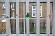 The remains of Christmas, a few Christmas stickers left on the bars of the community room on B-wing in HMP Downview, Surrey, United Kingdom. HMP Downview is a women's closed category prison for adult sentenced women and convicted and remand female young people located on the outskirts of Banstead in Surrey, England. (Picture credit: © Andy Aitchison)