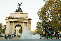 EDITORIAL USE ONLY Participants drive through Wellington Arch during the Bonhams London to Brighton Veteran Car Run in London.