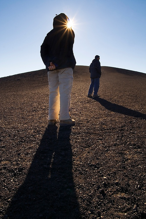 Liana and Parmenter Welty stand on top of a large barren mound of volcanic pumice deposited by lava flows thousands of years ago at Craters of the Moon National Monument, Idaho.