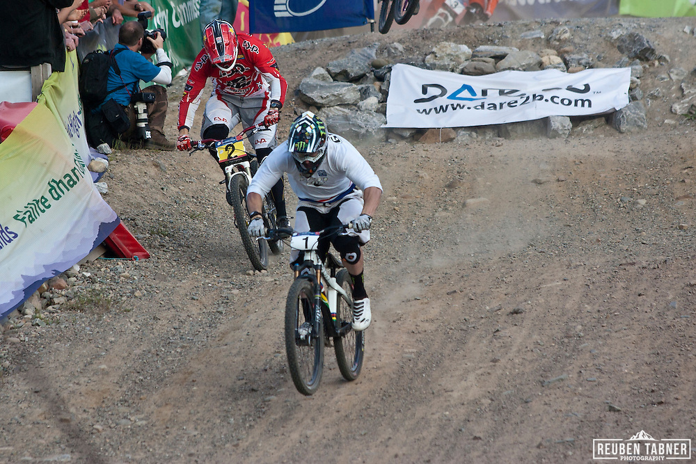Jared Graves (AUS) steams ahead to take first place ahead of Joost Wichman (NED) in the men's final of the Four Cross (4X) at the UCI Mountain Bike World Cup in Fort William, Scotland.