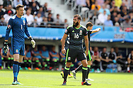 Joe Ledley of Wales shows his frustration as he shouts at Wales goalkeeper Wayne Hennessey.  Euro 2016, group B , England v Wales at Stade Bollaert -Delelis  in Lens, France on Thursday 16th June 2016, pic by  Andrew Orchard, Andrew Orchard sports photography.