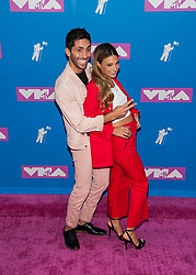 August 21, 2018 - New York City, New York, USA - 8/20/18.Nev Schulman and Laura Perlongo at the 2018 MTV Video Music Awards at Radio City Music Hall in New York City. (Credit Image: © Starmax/Newscom via ZUMA Press)