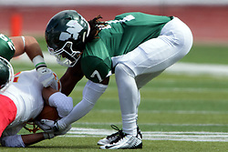 19 September 2015:  Tyrell Bolden works to try and release the ball from an opponents hands  during an NCAA division 3 football game between the Simpson College Storm and the Illinois Wesleyan Titans in Tucci Stadium on Wilder Field, Bloomington IL