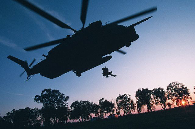 1995, Brindisi, Italy --- A member of the Air Force 352nd Special Operations Group rappels from a helicopter. Many Air Force Special Tactics Squadrons were integrated into Operation Joint Endeavor to keep the peace in Bosnia. --- Image by © Leif Skoogfors