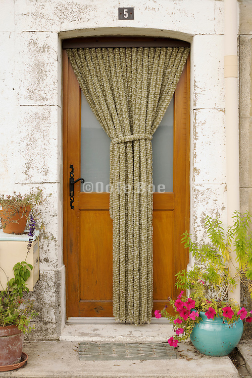 door with protection curtain to keep flies outside