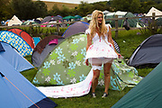 A woman dressed as a bloody bride at the Standon Calling Festival in Hertfordshire, UK<br /> Standon Calling is a small independent festival set among the hills in Herfordshire that showcases World Music, Indie Music and dance Music. It is one of the new, small and quirky boutique festivals which have become popular in the UK.