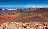 Looking down at the beginning of the Sliding Sands (Keonehe'ehe'e) Trail from the Pa Ka'oao trail near the summit of the inactive volcano Haleakala. In the background one can just make out the Big Island.