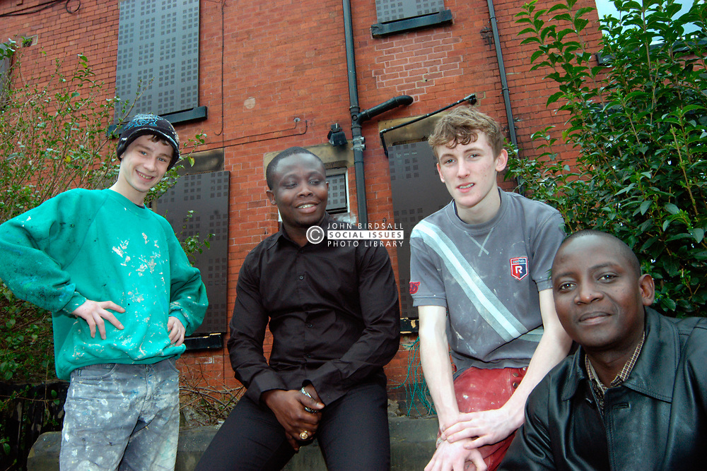 Beecan Housing Project; Beeston; Leeds, Local young men learn building skills to renovate derelict houses for refugees UK