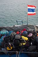 At the stern of a ferry transporting passengers from the Thai islands of Ko Phangan and Ko Samui to the mainland, backpacks of various brands are stacked together. (July 2017)