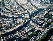 Nederland, Amsterdam, Muntplein, 17-10-2005;  het water van de rivier de Amstel loopt langs het Muziektheather en Stadhuis (rechtsboven), naar het hart van Amsterdam: het Muntplein met Munttoren (precies in het midden van de foto); na het plein heet de rivier de Amstel Singel (Bloemenmarkt, naar linksonder); de schaduw van de Munt valt op Hotel de l'Europe, links hiervan de Oude Turfmarkt; andere landmarks: Allard Pierson Museum, Zuiderkerkstoren, Stopera, Carltonhotel (Vijzelstraat), Rembrandtplein; grachtengordel, toerisme, economie; historisch centrum van de stad, stadshart..zie ook andere (lucht)foto's van deze locatie..foto Siebe Swart