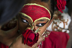 Like other kumaris, Kumari Dangol wears special makeup for festivals. But it's more than makeup that changes on these occasions. Former kumaris have described feeling bigger and stronger and said that heat radiates from their foreheads.