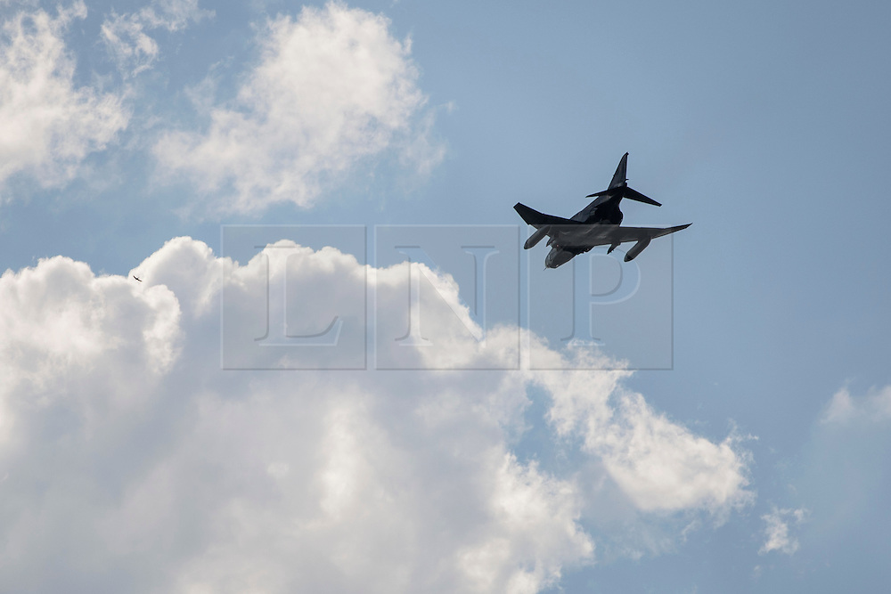 "© licensed to London News Pictures. London, UK 23/06/12. A Turkish F-4 Phantom jet leaves Eskisehir Military Airport on 26/07/11. Today the Syrian military has said it shot down a F-4 Phantom Turkish plane ""flying in airspace over Syrian waters"". Two crew members are being searched for over the Mediterranean sea. Photo credit: Tolga Akmen/LNP"