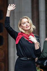 © Licensed to London News Pictures. 08/07/2020. London, UK. Amber Heard arrives at The High Court in Central London for the second day of the trial. Johnny Depp's libel trial against The Sun newspaper is due to take place over the next three weeks over allegations he was violent and abusive towards his ex-wife Amber Heard. Photo credit: Rob Pinney/LNP