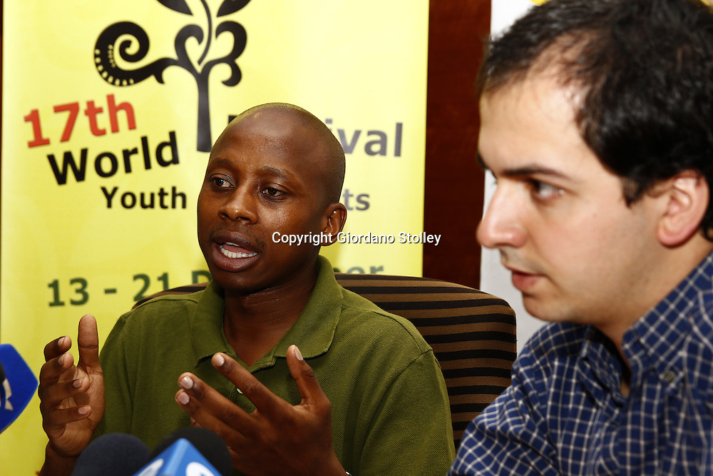 MIDRAND - 9 December 2010 - National Youth Development Agency chairman Andile Lungisa explains that R40 million in funding has come from the National Lotteries Board for the 17th World Festival of Youth and Students as Federation of Democratic Youth President Tiago Vieira looks on. -- APP/Allied Picture Press