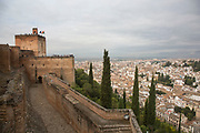 The Alhambra Palace and fortress complex located in Granada, Andalucia, Spain. View looking out from the Alcazaba across the closely packed rooftops of Albaicin, the old Muslim quarter of Granada. Albaicin is a district of that retains the narrow winding streets of its Medieval Moorish past. It was declared a world heritage site in 1984, along with the Alhambra.