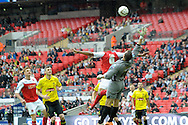 Burton Albion's goalkeeper Dean Lyness is helpless as Fleetwood Town's  Antoni Sarcevic (out of picture ) scores his sides 1st goal.   Skybet football league two play off final match , Burton Albion v Fleetwood Town at Wembley Stadium in  London on Monday 26th May 2014.<br /> pic by John Patrick Fletcher, Andrew Orchard sports photography.