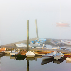 Skiffs and morning fog in Southwest Harbor, Maine. Near Acadia National Park.