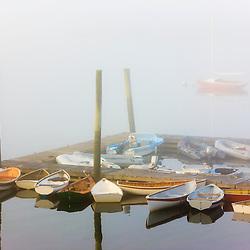 Skiffs and morning fog in Southwest Harbor, Maine. Near Acadia National Park.