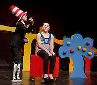 """Catherine McLaughlin as """"The Cat in the Hat"""" and Erin Gately at """"Gertrude McFuzz"""" rehearse for Gilford Middle School's production of """"Seussical"""" beginning Thursday evening through Saturday at 7pm with an additional Saturday matinee at 2pm.  (Karen Bobotas/for the Laconia Daily Sun)"""