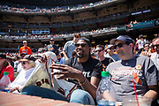 Golden State Warriors forward Kevin Durant signs autographs and watches the San Francisco Giants host the Los Angeles Dodgers at AT&T Park in San Francisco, California, on April 27, 2017. (Stan Olszewski/Special to S.F. Examiner)