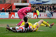 Luke McCormick gathers the ball during the Sky Bet League 2 match between Cheltenham Town and Plymouth Argyle at Whaddon Road, Cheltenham, England on 28 March 2015. Photo by Alan Franklin.