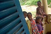 Group of children on front porch of a house.