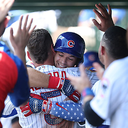 July 4, 2018 - Chicago, IL, USA - The Chicago Cubs' David Bote is hugged by teammate Albert Almora Jr. (5) after hitting his first major league home run, in the second inning against the Detroit Tigers, at Wrigley Field in Chicago on July 4, 2018. (Credit Image: © John J. Kim/TNS via ZUMA Wire)