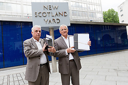 © Licensed to London News Pictures. 09/06/2015. London, UK. Tower Hamlets election petitioner ANDY ERLAM (Andrew Erlam) and businessman, DANNY MARKS outside New Scotland Yard in central London on 8th June 2015. Andy Erlam and Danny Marks delivered new files of alleged evidence of election and financial fraud in Tower Hamlets to the Metropolitan Police Commissioner, Sir Bernard Hogan-Howe. Photo credit : Vickie Flores/LNP
