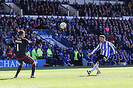 Sheffield Wednesday striker Gary Hooper (14) chips Cardiff City goalkeeper, David Marshall (1) to score the third goal 3-0 during the Sky Bet Championship match between Sheffield Wednesday and Cardiff City at Hillsborough, Sheffield, England on 30 April 2016. Photo by Phil Duncan.