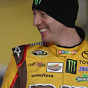 NASCAR Sprint Cup driver Kyle Busch (18) is seen during the driver introductions prior to the NASCAR Sprint Unlimited Race at Daytona International Speedway on Saturday, February 16, 2013 in Daytona Beach, Florida.  (AP Photo/Alex Menendez)