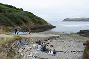 People on Summer holiday enjoy the seaside on 17th August 2021 in Pembrokeshire, Wales, United Kingdom. Newport is a town, parish, community, electoral ward and ancient port of Parrog, on the Pembrokeshire coast in West Wales at the mouth of the River Nevern in the Pembrokeshire Coast National Park.