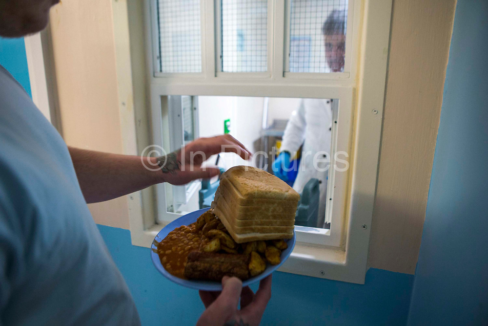 Lunch from the canteen, a prisoner get 7 slices of bread to go with his eggs, chips and beans.  Beaufort House, a skill development unit for enhanced prisoners. Part of HMP/YOI Portland, a resettlement prison with a capacity for 530 prisoners.Dorset, United Kingdom.