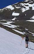 Cross Country Skier, walking across landscape, backpacking, snow capped mountain, hiking