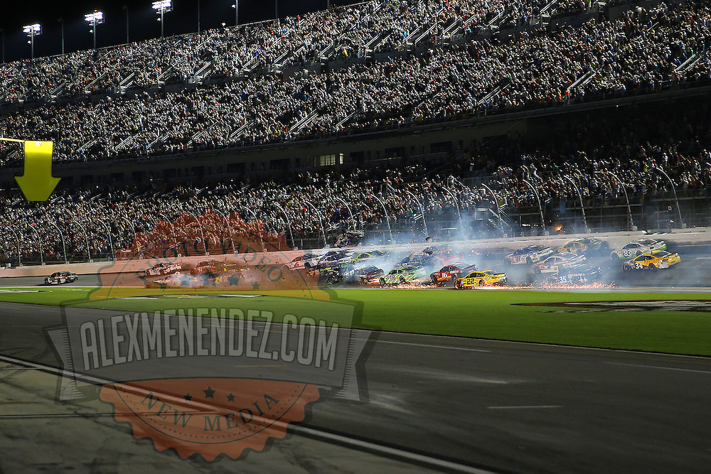 NASCAR Sprint Cup driver Austin Dillon (3) wrecks into the catch fence on the final lap of the 57th Annual NASCAR Coke Zero 400 stock car race at Daytona International Speedway on Monday, July 6, 2015 in Daytona Beach, Florida.  (AP Photo/Alex Menendez)