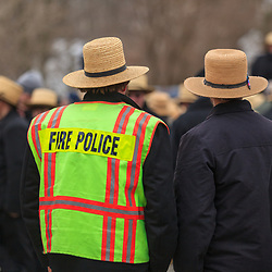 An Amish fire police officer at a public auction in Lancaster County, Pennsylvania.