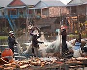 Fishermen of the floating village Kompong Phluk sorting their nets. Tonlé Sap lake, Cambodia