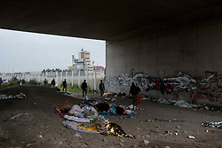 October 26, 2016 - Calais, France - From 4 o clock in the morning, the first migranrs arrived at the entrance of the warehouse. Long hours of waiting was expected. Calais, France on 26 October 2016. (Credit Image: © Guillaume Pinon/NurPhoto via ZUMA Press)