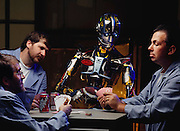 MODEL RELEASED. Entertainer android robot. View of Sarcos, an android (human-like) entertainment robot, playing seven-card-stud poker with a group of robot engineers. Sarcos was developed at SARCOS Research Corporation in Salt Lake City, Utah, USA. Robo sapiens Project.