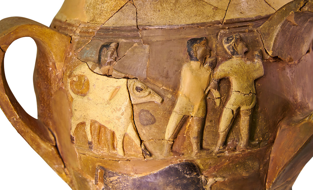 Hüseyindede vases, Old Hittite Polychrome Relief vessel, close up depicting a bull being led to be sacrificed, following Hittite convention of sacrificing an animal of the same gender as the God this bull indicates the sacrifice is to a male god, 16th century BC.. Çorum Archaeological Museum, Corum, Turkey. Against a white bacground. .<br /> <br /> If you prefer to buy from our ALAMY STOCK LIBRARY page at https://www.alamy.com/portfolio/paul-williams-funkystock/hittite-art-antiquities.html  - Huseyindede into the LOWER SEARCH WITHIN GALLERY box. Refine search by adding background colour, place, museum etc<br /> <br /> Visit our HITTITE PHOTO COLLECTIONS for more photos to download or buy as wall art prints https://funkystock.photoshelter.com/gallery-collection/The-Hittites-Art-Artefacts-Antiquities-Historic-Sites-Pictures-Images-of/C0000NUBSMhSc3Oo