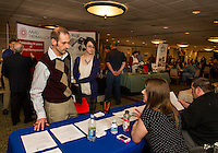 Todd Lajoie and Alexandria Dodd talk with Jessica Card and Jason Lamontagne from Metrocast during the Lakes Region Job Fair presented by the Lakes Region Chamber of Commerce at the Margate Resort Wednesday afternoon.  (Karen Bobotas/for the Laconia Daily Sun)