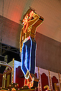 The 40 foots tall neon cowboy Vegas Vic on the Pioneer, downtown Las Vegas, Nevada.