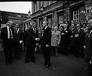 Newly Elected TD Enda Kenny Arrives at The Dail..(J89)..1975..18.11.1975..11.18.1975..18th November 1975..Following the death of his father,Henry Kenny TD, Enda Kenny was proposed by the Fine Gael party to contest the seat. He was duly elected and went to Dublin to take up his seat in Dail Eireann at Leinster House, Dublin. .Image of Enda Kenny  and An Taoiseach, Liam Cosgrave, surrounded by supporters, many of whom had travelled by bus from Mayo to attend Endas' first day as a T.D.