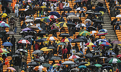 60813880<br /> Supporters attend the memorial service for Nelson Mandela in Johannesburg, South Africa, on Dec. 10, 2013. Memorial service for former South African president Nelson Mandela started in Johannesburg on Tuesday as tens of thousands of mourners and more than 90 world leaders gather in rain to remember Mandela at memorial at the FNB Stadium in Soweto near Johannesburg, South Africa, Tuesday, 10th December 2013. Picture by  imago / i-Images<br /> <br /> UK ONLY