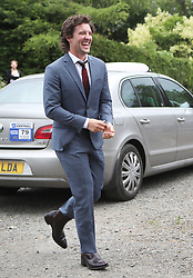 Actor Jack Donnelly arrives at Rayne Church, Kirkton of Rayne in Aberdeenshire, for the wedding ceremony of Game Of Thrones stars Kit Harington and Rose Leslie.