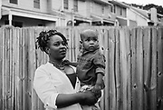 """BIRMINGHAM, AL – MAY 20, 2016: Marquita Smiley, 33, holds her 2-year-old son Zaidan in the backyard.<br /> <br /> While pregnant in 2014, Marquita Smiley was prescribed Zofran to help her cope with severe morning sickness. At her 20 week ultrasound, the OB/GYN discovered signs that her son was suffering from hypoplastic left heart syndrome – a rare heart defect resulting in a severely underdeveloped heart. Months later, her newborn Zaidan was placed on a transplant list, and he ultimately underwent surgery as a 2-month-old to replace the failed organ.<br /> <br /> Initially developed as a drug to help cancer patients suffering from the side-effects of chemotherapy, Zofran (generic name ondansetron) has become widely prescribed by doctors to treat morning sickness among pregnant mothers. Pharmaceutical companies point to studies that deny any link between the drug and birth defects, yet somehow ondansetron has avoided the strict barrier of clinical trials required by the Food and Drug Administration to validate its use among pregnant women. Absent of any data, critics argue that pregnant women and their babies are susceptible to unknown risks.<br /> <br /> It wasn't until months after Zaidan's heart transplant that the Zofran controversy was brought to Marquita Smiley's attention. """"Mentally more than anything it was life changing,"""" Smiley said. """"We watched him code several times, so I really don't want anybody to have to experience this. If [the drug] is what caused it, people need to know what they're getting into."""""""