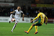 Swansea city's Chico Flores goes past Ivelin Popov. ®.UEFA Europa league match, Swansea city v FC Kuban Krasnodar at the Liberty Stadium in Swansea, South Wales on Thursday 24th October 2013. pic by Andrew Orchard, Andrew Orchard sports photography,