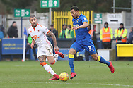 AFC Wimbledon defender Darius Charles (32) taking on Blackpool's Kyle Vassell (7) during the EFL Sky Bet League 1 match between AFC Wimbledon and Blackpool at the Cherry Red Records Stadium, Kingston, England on 20 January 2018. Photo by Matthew Redman.