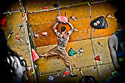 SHOT 6/5/11 11:45:10 AM - Brian Gallant of Colorado Springs, Co. works his way through a problem in the Citizen's Bouldering competition at the 10th Annual Teva Mountain Games in Vail, Co. Professional and amateur outdoor adventure athletes from the Vail Valley and around the world will converge upon the mountains and rivers of Vail to compete in eight sports and 23 disciplines including: x-country, freeride, slopestyle and road cycling, freestyle, 8-Ball, sprint and extreme kayaking, raft cross, World Cup Bouldering, stand up paddle sprint and surf cross, as well as trail, mud and road running, dog comps and the GNC Ultimate Mountain Challenge.. (Photo by Marc Piscotty / © 2010)