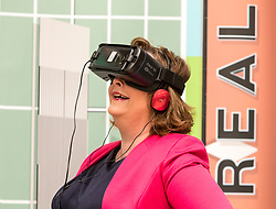 Cabinet Secretary for Culture, Tourism and External Affairs, Fiona Hyslop visits one of the highlights of the annual Edinburgh International Science Festival, Play On at the National Museum of Scotland. Play On is a family-friendly, interactive exhibition which is divided into four zones (Game Theory, Make Some Noise, Toy Box and Picture This) and explores how technology influences our leisure time.<br />  <br /> Ms Hyslop met with the Science Festival's Directors, Simon Gage and Amanda Tyndall, as well as the artists and designers behind the Play On.<br /> <br /> <br /> Pictured: Fiona Hyslop using a Virtual Reality headset